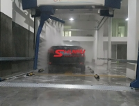 AXE OVERHEAD touchless carwash system installation finished in Asia